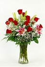 Prestige Roses and Lilies Vased from Flowers by Ray and Sharon in Muskegon, MI